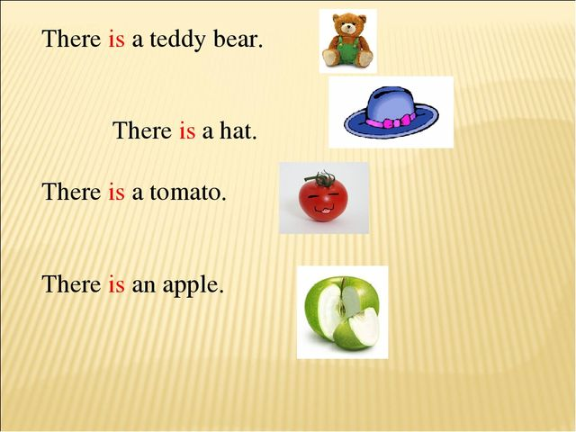 There is a teddy bear. There is a hat. There is a tomato. There is an apple.